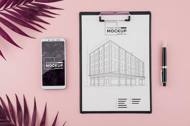 Архитектурный чертеж сверху с мобильным телефоном и ручкой Бесплатные Psd