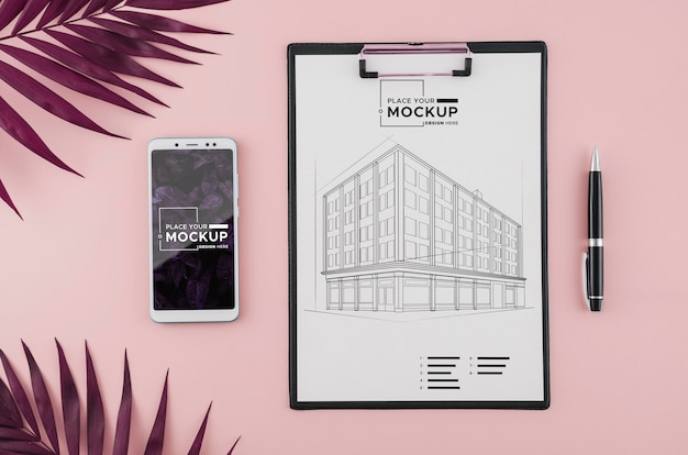 Top view architecture drawing with mobile phone and pen Free Psd