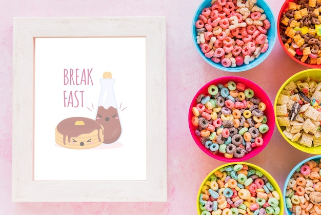 Top view of arrangement of cereals bowls and frame Free Psd