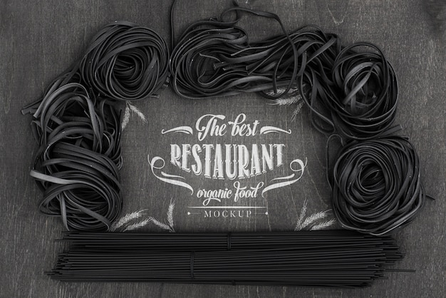 Top view arrangement of dark spaghetti mock-up Free Psd