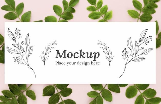 モックアップと緑の葉の上面図の配置 無料 Psd