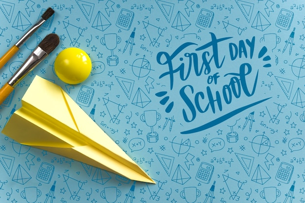 Top view arrangement with paper airplane and brushes Free Psd