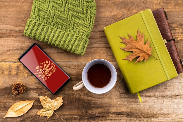Top view autumn arrangement with hat and coffee cup Free Psd