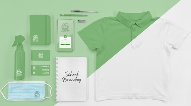 Top view of back to school essentials with t-shirt and medical mask Premium Psd