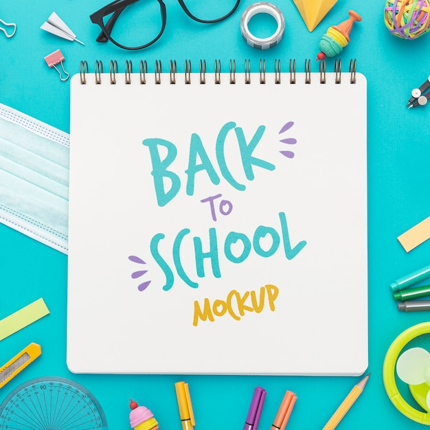 Top view of back to school notebook with glasses and pencils Free Psd