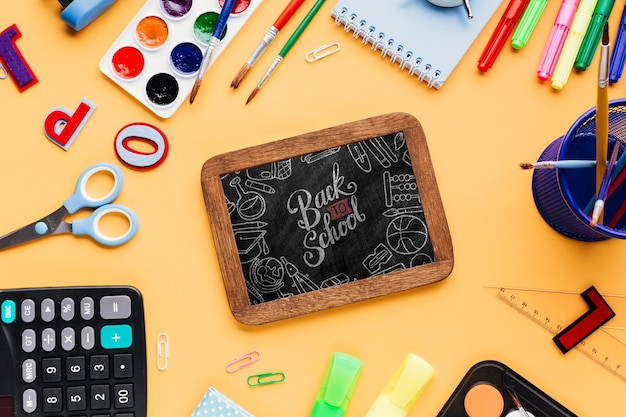 Top view back to school with mock-up chalkboard Free Psd