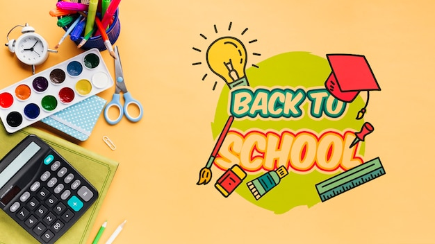Top view back to school with orange background Free Psd