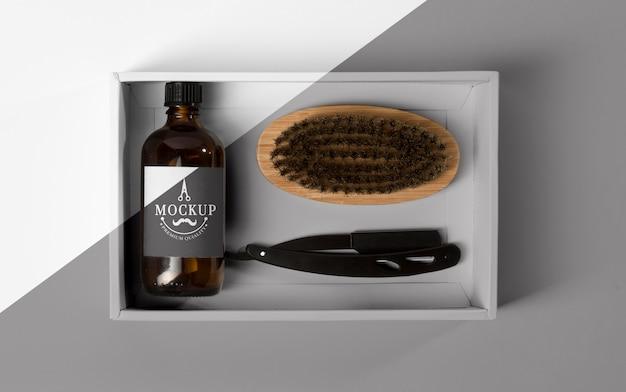 Vista dall'alto della scatola dei prodotti da barbiere con rasoio e pettine Psd Gratuite