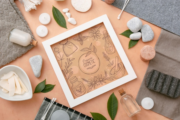Top view of beauty spa essentials with frame and candles Free Psd