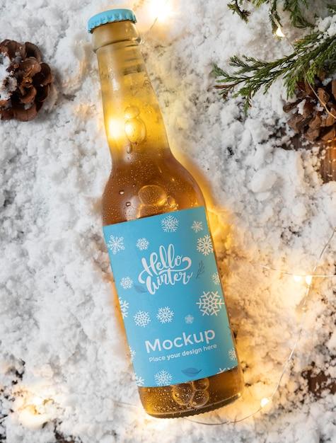 Top view beer bottle in snow Premium Psd