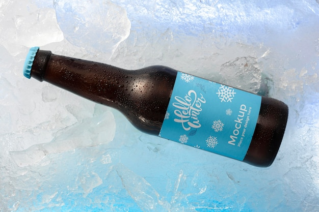 Top view beer bottle in snow Free Psd
