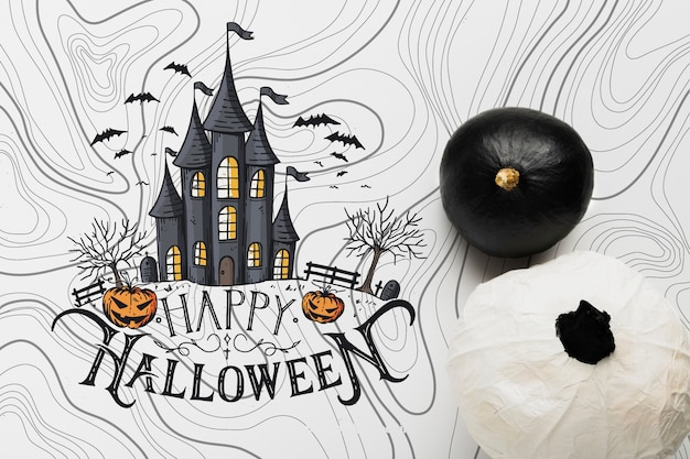 Top view of black and white pumpkins with haunted house Free Psd