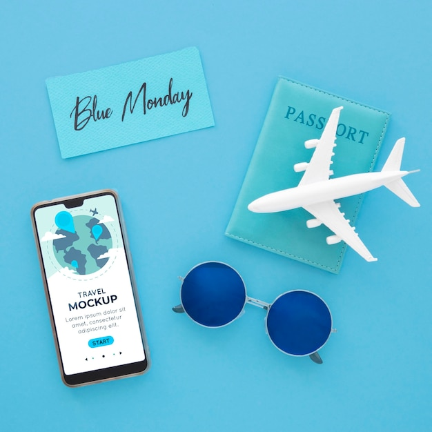 Vista dall'alto dell'aeroplano blu lunedì con smartphone e occhiali da sole Psd Gratuite