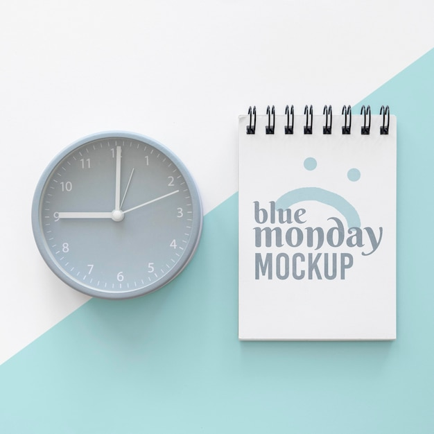 Top view of blue monday notebook with clock Free Psd