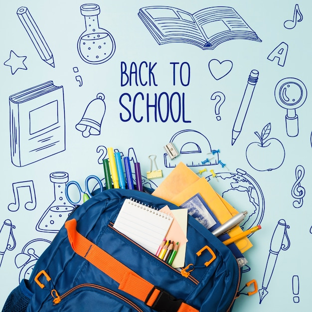 Top view blue school bag with supplies Free Psd