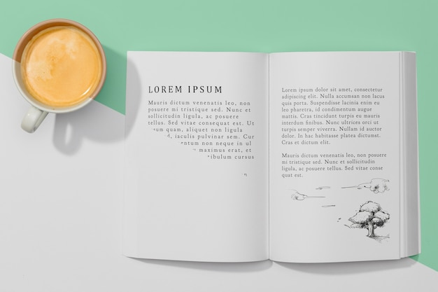 Top view book mock-up with coffee Free Psd