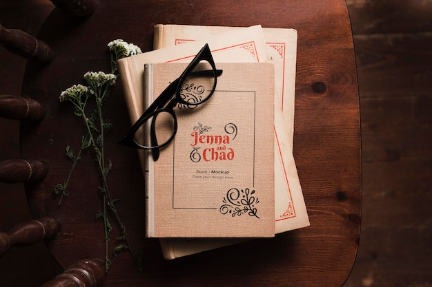 Top view of books on chair with glasses Free Psd