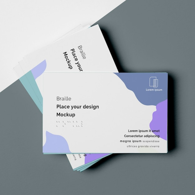 Top view of business card designs with braille writing Free Psd
