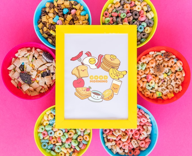 Top view of cereal bowls and frame with pink background Free Psd