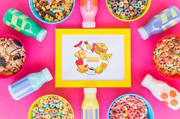 Top view of cereal bowls and milk bottles on pink background Free Psd