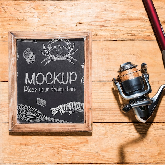 Top view of chalkboard with fishing rod Free Psd