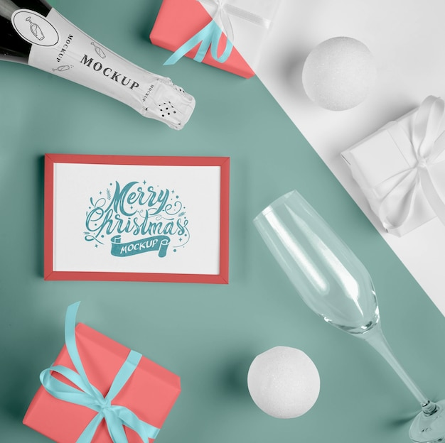 Top view of a champagne bottle with a christmas frame Free Psd