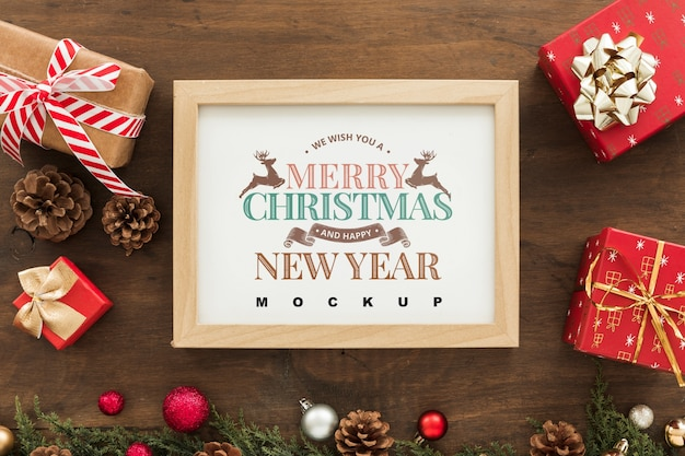 Top view christmas composition with frame mockup Free Psd