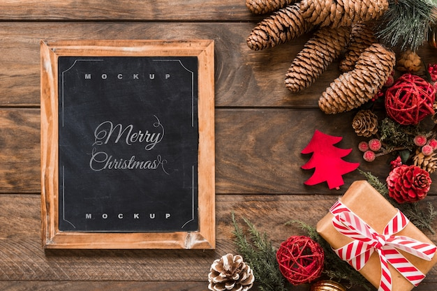 Top view christmas composition with slate mockup Free Psd