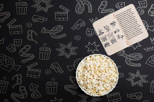 Top view cinema arrangement on black background with hand drawn elements Free Psd