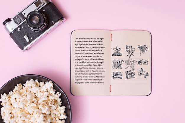 Top view cinema arrangement on pink background Free Psd