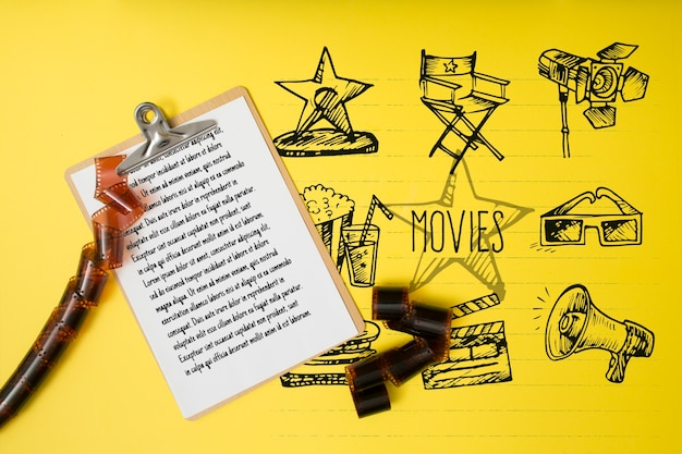 Top view cinema arrangement on yellow background Free Psd