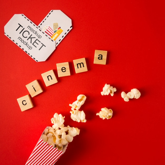 Top view cinema scrabble letters and tickets Free Psd
