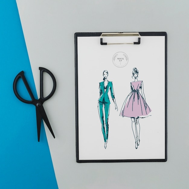Top view clipboard with drawing and scissors Free Psd