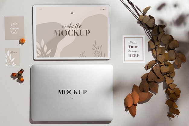 Top view closed laptop with mockup with leaves Free Psd