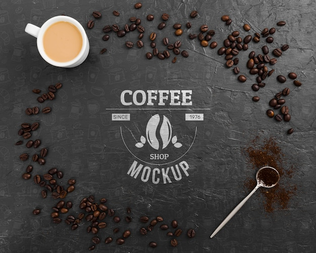 Top view coffee beans and cup of coffee mock-up Free Psd