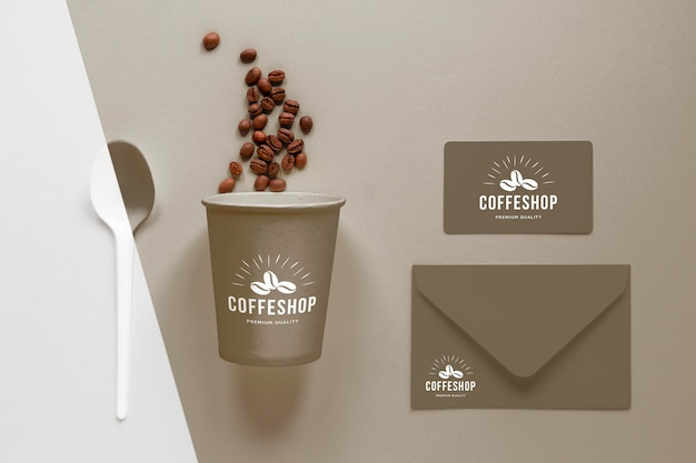 Top view coffee cup, beans and notebook Free Psd