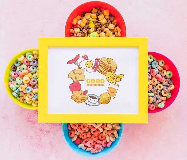 Top view of colorful cereals and frame on plain background Free Psd
