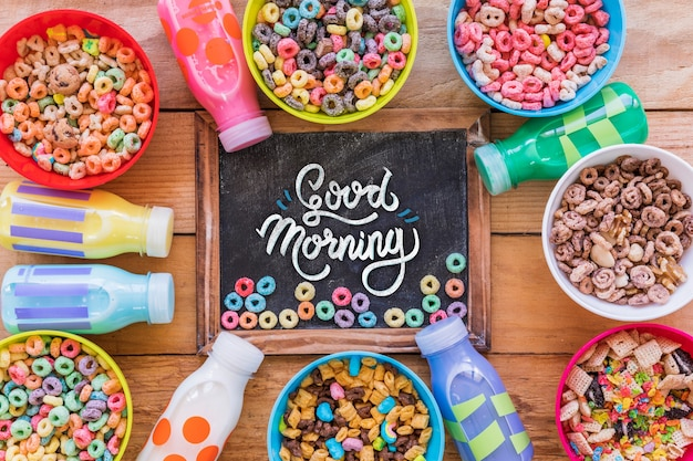 Top view of colorful cereals on wooden table Free Psd