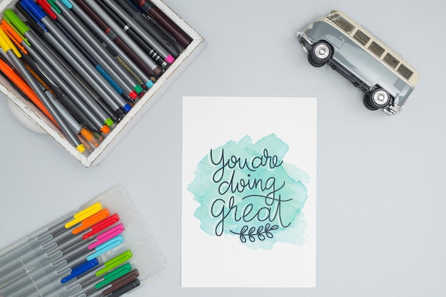 Top view colorful pens with toy car Free Psd