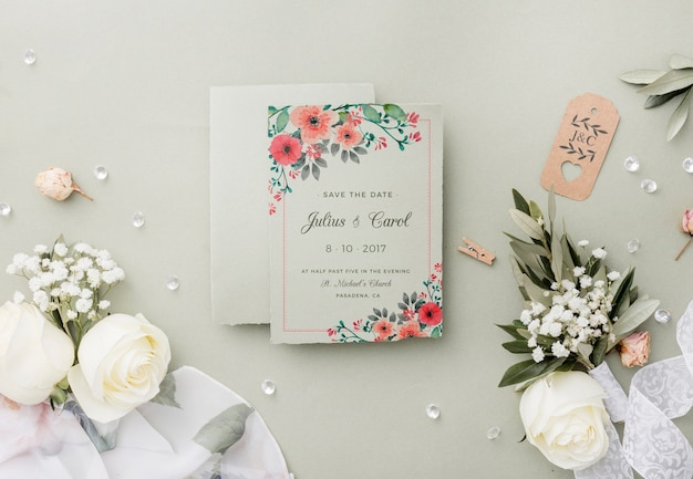 Top view composition of wedding elements with invitation mock-up Free Psd