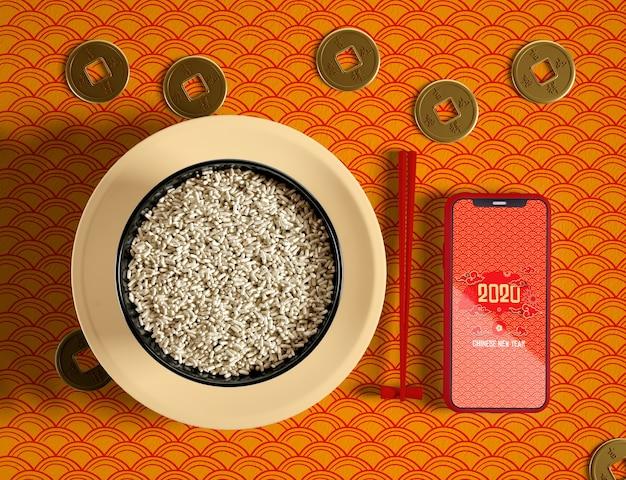 Вид сверху вкусная миска риса и телефон макет Бесплатные Psd