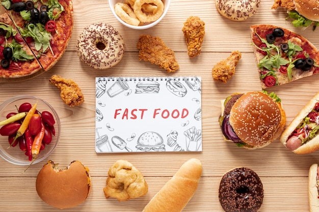 Top view of delicious fast food on wooden table Free Psd