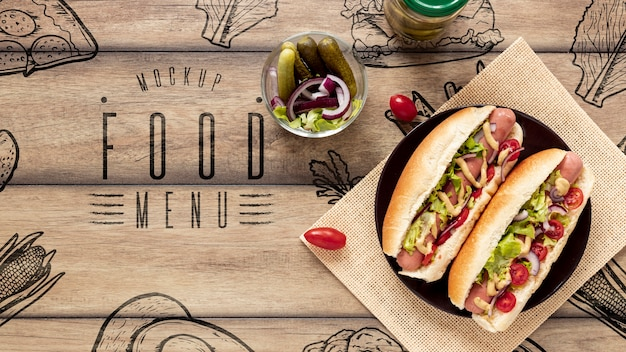 Top view of delicious hot dogs on wooden table Free Psd
