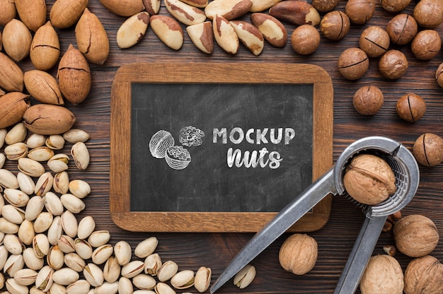 Top view of delicious nuts mock-up Free Psd