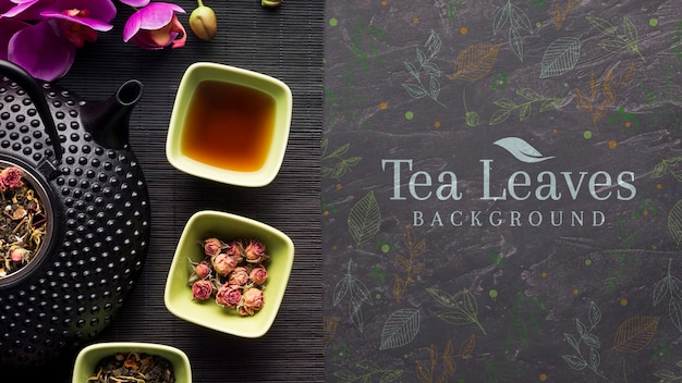 Top view delicious tea leaves background Free Psd