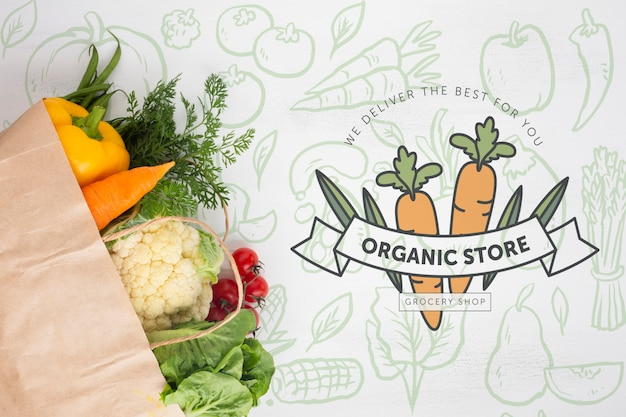 Vista dall'alto deliziose verdure in un sacchetto di carta Psd Gratuite