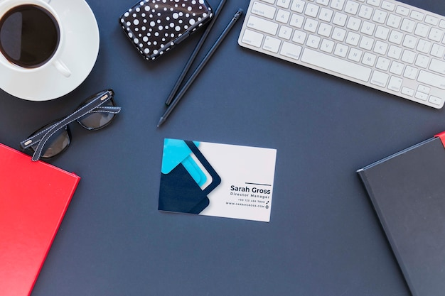 Top view desk concept with business card Free Psd