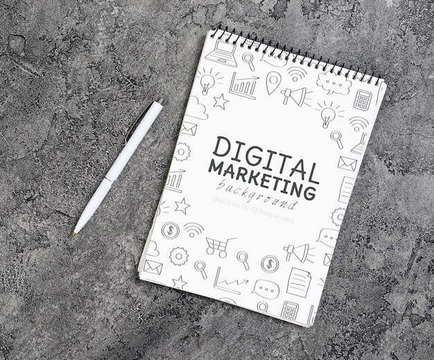 Vista dall'alto del taccuino di marketing digitale Psd Gratuite