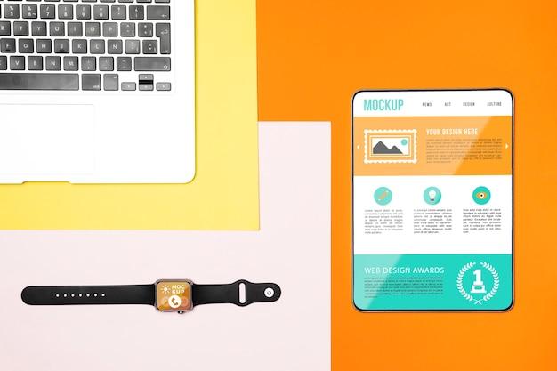 상위 뷰 디지털 태블릿 및 노트북 모형 무료 PSD 파일