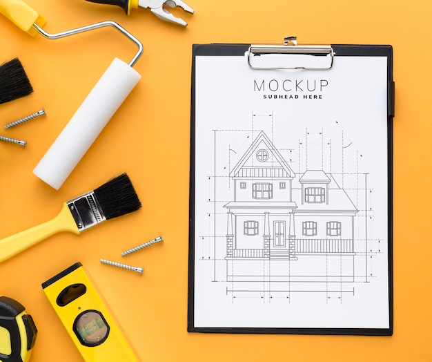 Top view engineering tools with clipboard mock-up Free Psd